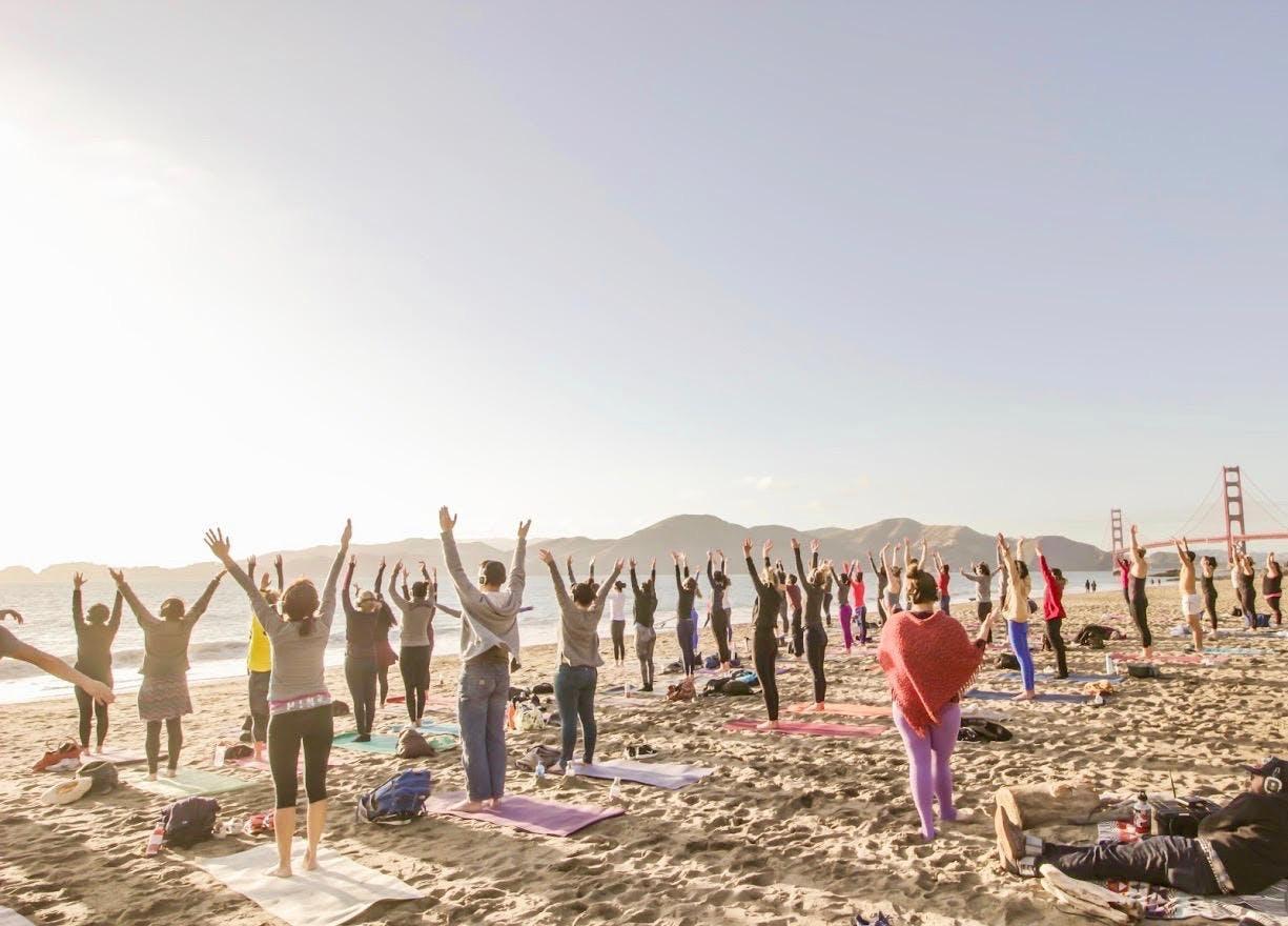 Saturday Groove: Silent Disco Beach Yoga with Sarah Allison!